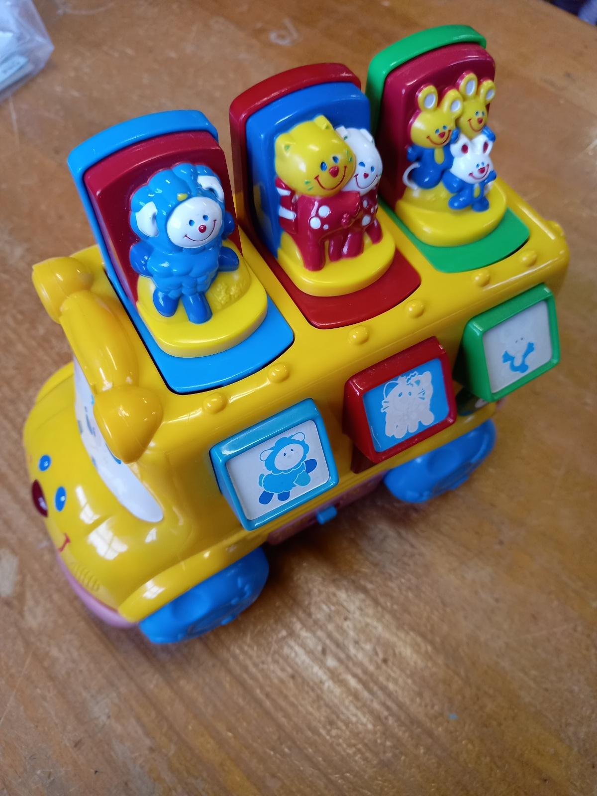 Musical nursery rhyme pop-up bus